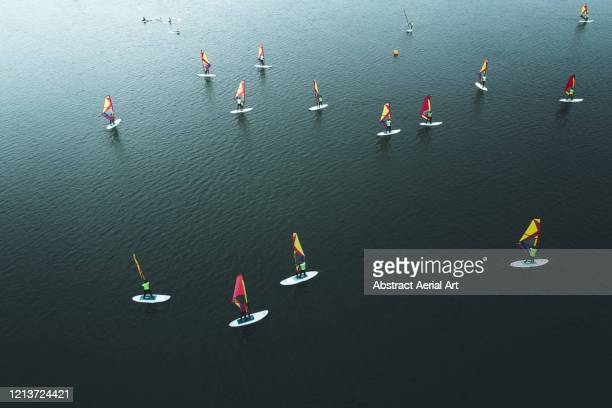 aerial shot of a group of windsurfers, ouddorp, netherlands - sportevenement stockfoto's en -beelden