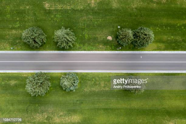 aerial shot of a straight bicycle lane in the park - straight stock pictures, royalty-free photos & images