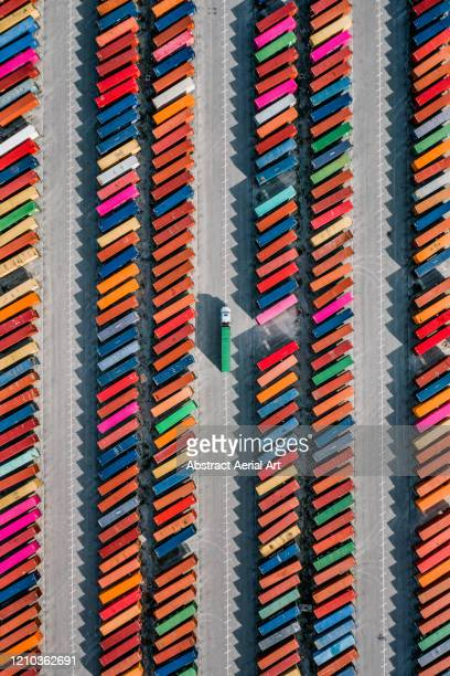 aerial shot of a truck picking up a cargo crate in a container yard, georgia, united states of america - vertical stock pictures, royalty-free photos & images