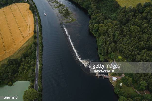 aerial shot of a weir, loch ness, scotland, united kingdom - drone point of view stock pictures, royalty-free photos & images