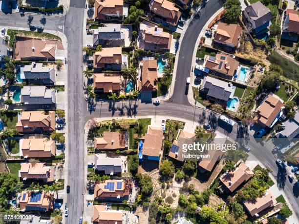 aerial shot of anonymous middle class neighborhood - santa clarita stock photos and pictures