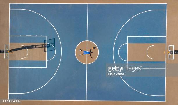 Aerial shot of basketball player lying outstretched on court