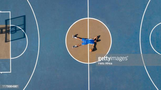 Aerial shot of basketball player relaxing on court