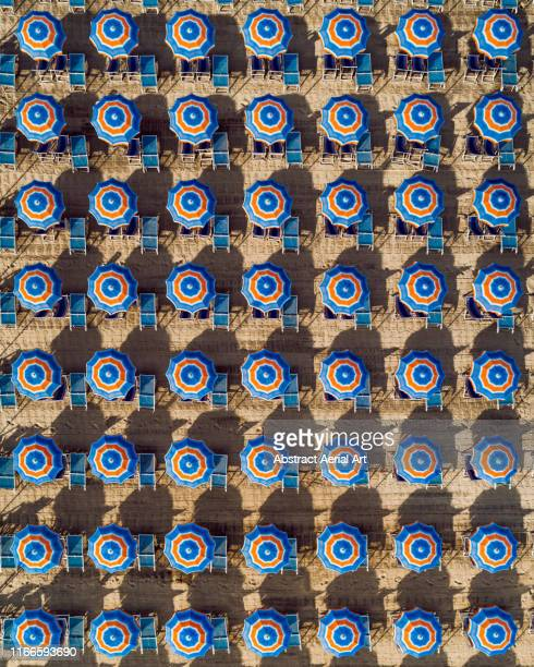 aerial shot of beach umbrellas, massa, italy - posizione descrittiva foto e immagini stock