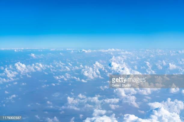 aerial shot of blue sky with clouds - alleen lucht stockfoto's en -beelden