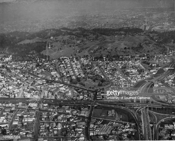 Aerial shot of Chavez Ravine and surrounding area, including the I-110 and I-101 Freeways , with the Hollywood hills visible in the distance. Dodger...