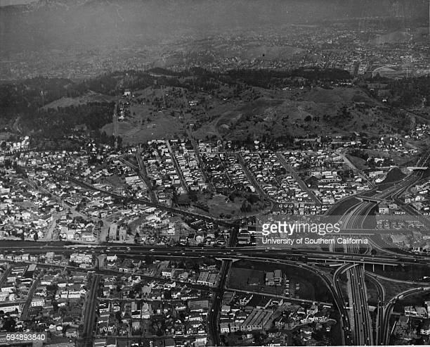Aerial shot of Chavez Ravine and surrounding area, including the I-110 and I-101 Freeways , with the Hollywood hills visible in the distance,...