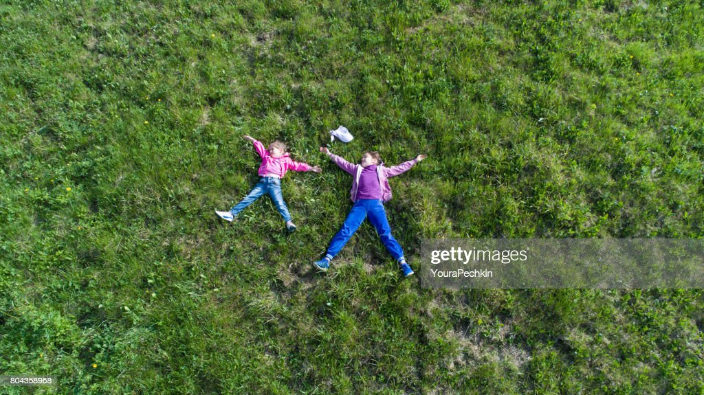 Aerial Shot Of Children At Green Grass Stock Photo