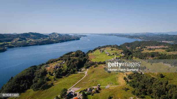 aerial shot of coastal lindas village, norway on a summer afternoon - hordaland county stock pictures, royalty-free photos & images