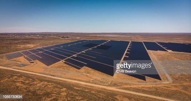 aerial shot of desert solar electricity plant - solar powered station stock pictures, royalty-free photos & images