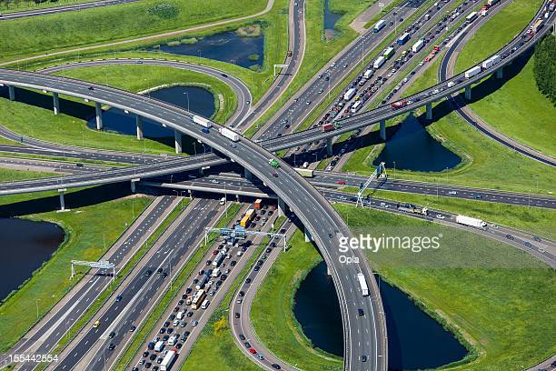 aerial shot of highway interchange - netherlands stock pictures, royalty-free photos & images