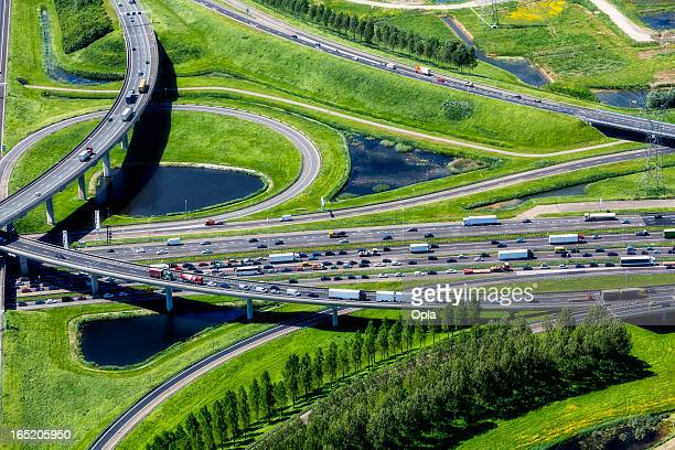 aerial shot of highway interchange - traffic stock pictures, royalty-free photos & images