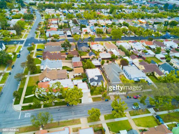 aerial shot of houses with green grass and trees - alhambra city of los angeles stock photos and pictures