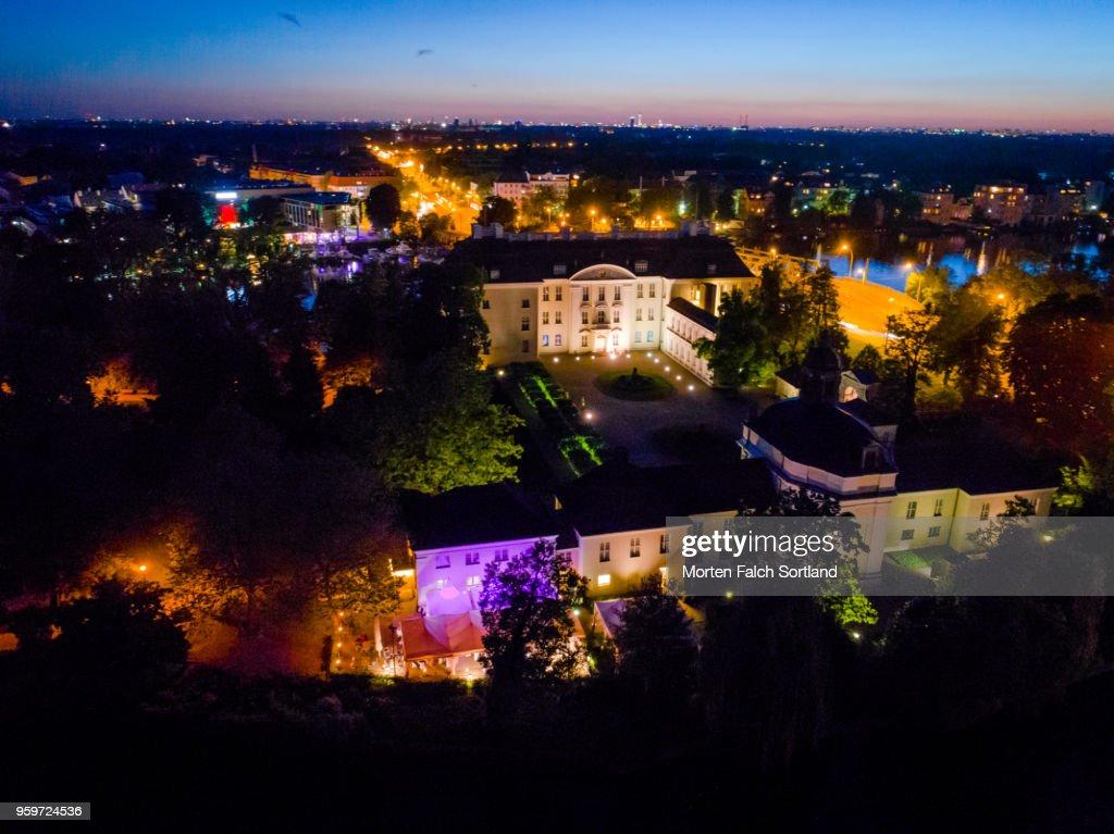 Aerial Shot of Illuminated Buildings at Night in Brandenburg, Germany Summertime : Stock-Foto