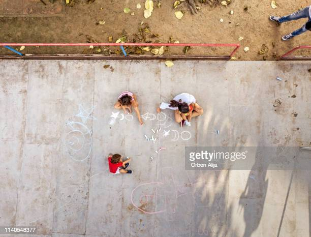aerial shot of kids laying on street - innocence stock pictures, royalty-free photos & images