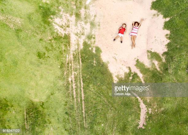 Aerial shot of kids lying on park