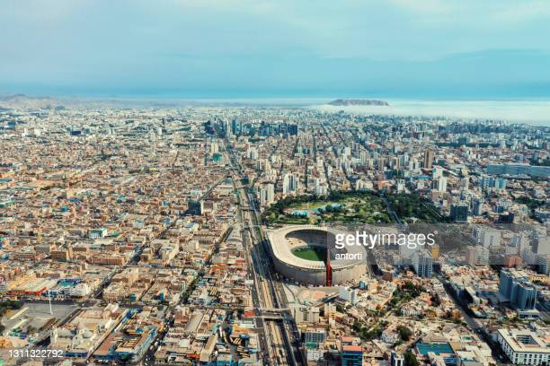aerial shot of lima peru national stadium and surroundings - olympic stadium stock pictures, royalty-free photos & images