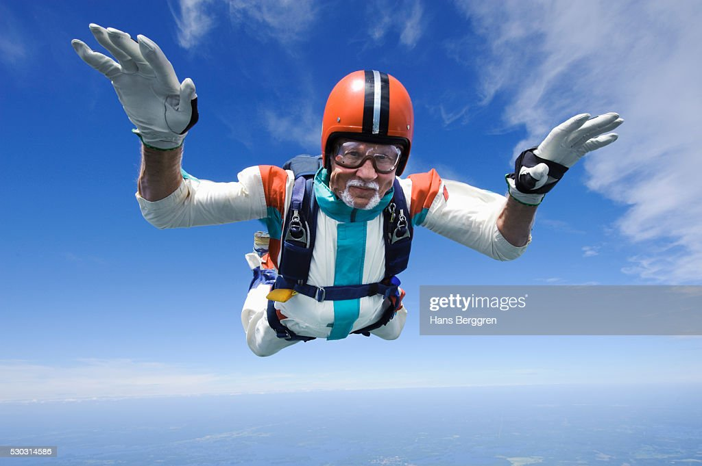 Aerial shot of man skydiving : Stock Photo