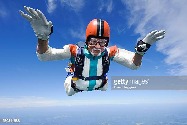 aerial shot of man skydiving - extreme sports stock pictures, royalty-free photos & images
