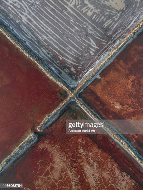 aerial shot of mine storage ponds, spain - x marks the spot stock pictures, royalty-free photos & images