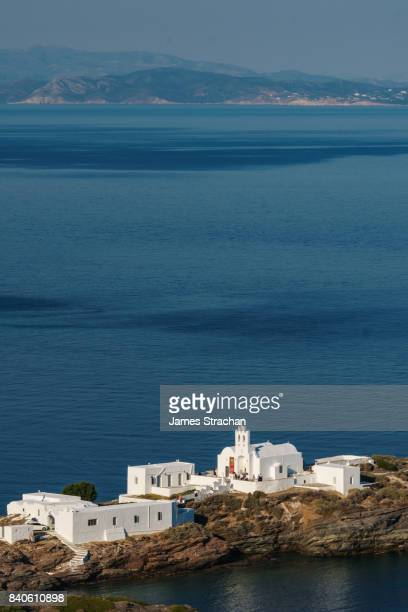 aerial shot of monastery of panagia chryssopigi (est 1650), with dark blue sea and island of antiparos in the background, sifnos, cyclades islands, greece - klooster stockfoto's en -beelden