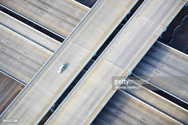 aerial shot of one car on freeway - empty stock pictures, royalty-free photos & images