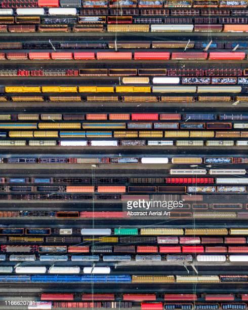 aerial shot of railroad cars, germany - 貨物列車 ストックフォトと画像