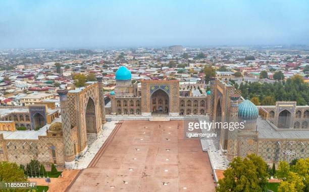 aerial shot of registan square, samarkand, historic silk road, uzbekistan - muziek stock pictures, royalty-free photos & images