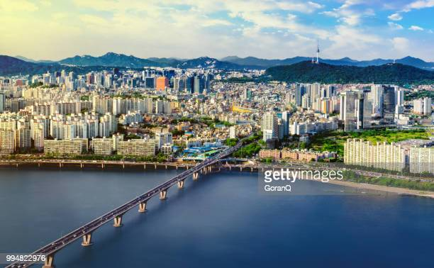 aerial shot of seoul city skyline and n seoul tower with traffic bridge, south korea - seoul stock pictures, royalty-free photos & images