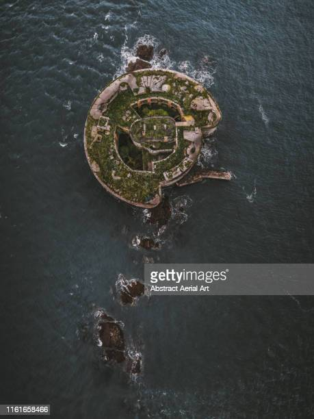 aerial shot of stack rock fort, pembrokeshire, wales, united kingdom - world war i stock pictures, royalty-free photos & images