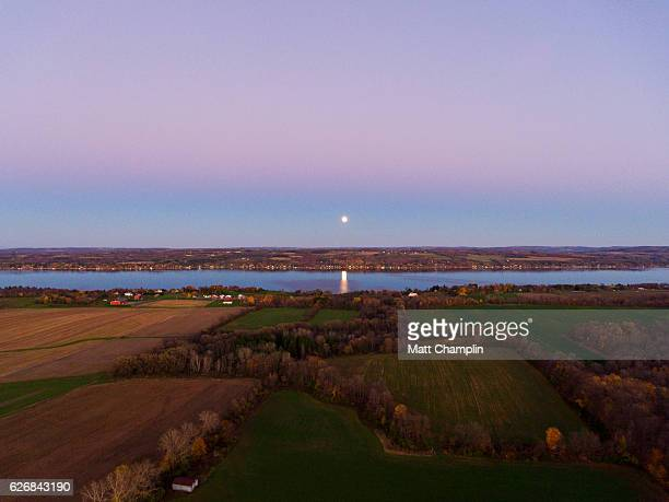 aerial shot of supermoon over lake - skaneateles lake stock pictures, royalty-free photos & images