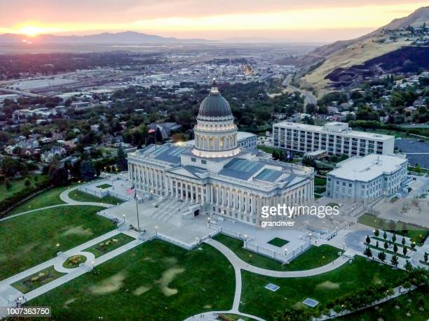aerial shot of the utah state capitol building and downtown salt lake city utah - salt lake city utah stock photos and pictures