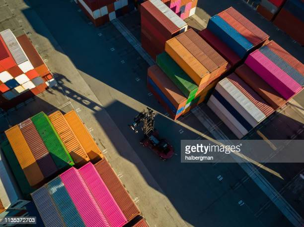 aerial shot of top handler in container yard - long beach california stock photos and pictures