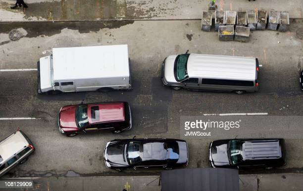 Aerial shot of traffic on grimy street