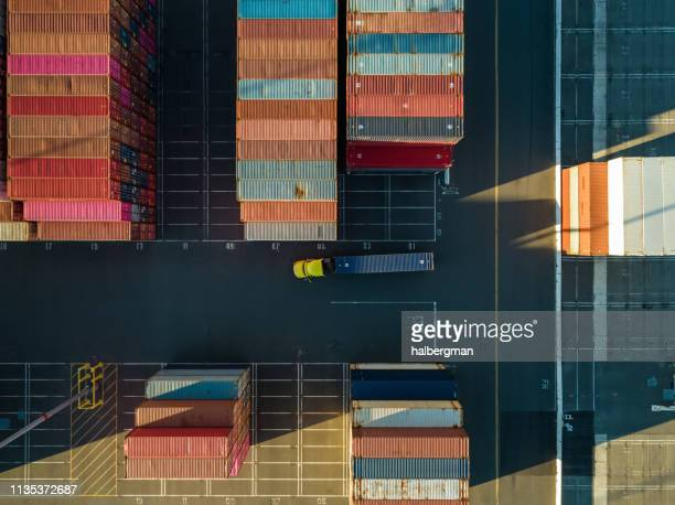 aerial shot of truck in container terminal from directly above - port of los angeles stock pictures, royalty-free photos & images
