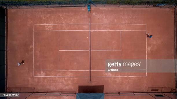 Aerial shot of two men playing tennis
