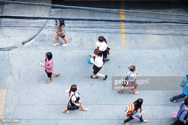 aerial shot of walking thai women - menschengruppe stock pictures, royalty-free photos & images