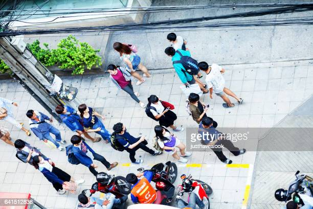 aerial shot of walking young thai - menschengruppe stock pictures, royalty-free photos & images