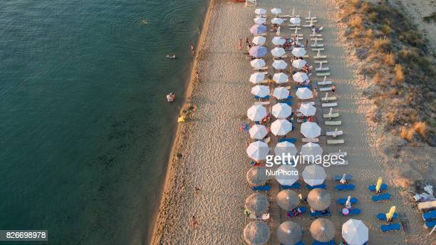 Aerial shots of Nea Irakleia a long sandy beach destination with crystal clear and calm water warm sea as it is in Themaikos gulf This beach is about...