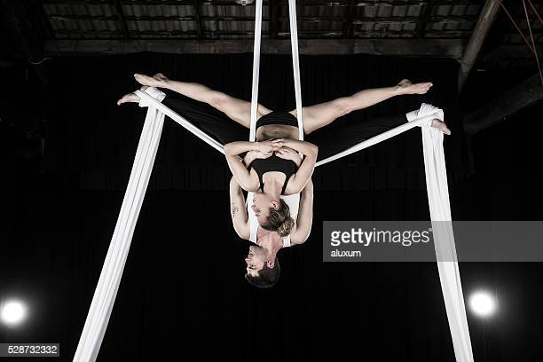 aerial silk dancers - acrobatic activity stock photos and pictures