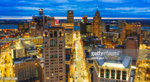 aerial skyline of detroit downtown with michigan at night - detroit stock pictures, royalty-free photos & images