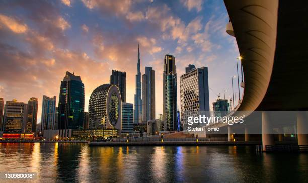 aerial skyline of downtown dubai filled with modern skyscrapers in the uae - downtown stock pictures, royalty-free photos & images