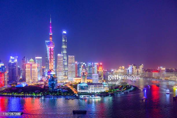 aerial skyline view of shanghai at dusk - shanghai stock pictures, royalty-free photos & images
