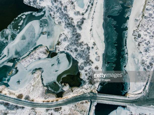 Aerial - Snow and Ice Covered Landscape with Empty Roads