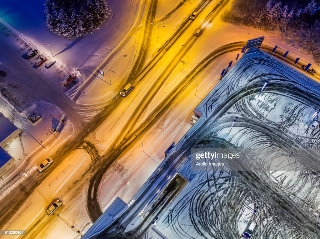 Aerial -  Snow Covered Winter Roads and Empty Parking Lot : Stock Photo