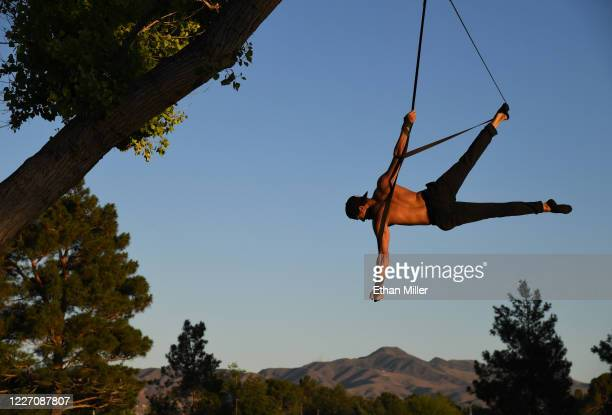Aerial straps artist and dancer Denis Bazhenov from the WOW The Vegas Spectacular show at the Rio Hotel Casino trains for his act using a tree at...