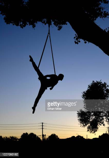 Aerial straps artist and dancer Denis Bazhenov from the WOW The Vegas Spectacular show at the Rio Hotel Casino is silhouetted as he trains for his...