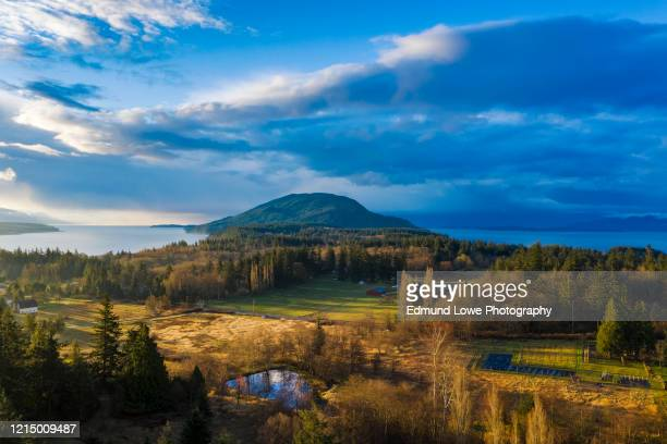 aerial sunrise panorama of lummi island, washington. - north pacific stock pictures, royalty-free photos & images