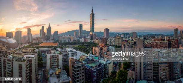 aerial sunrise panoramic view of taipei city crowded of building with the taipei101 building at the center - impossiable stock pictures, royalty-free photos & images