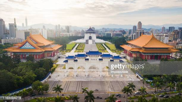 aerial sunrise view from drone of chiang kai-shek memorial hall with taipei city - impossiable stock pictures, royalty-free photos & images